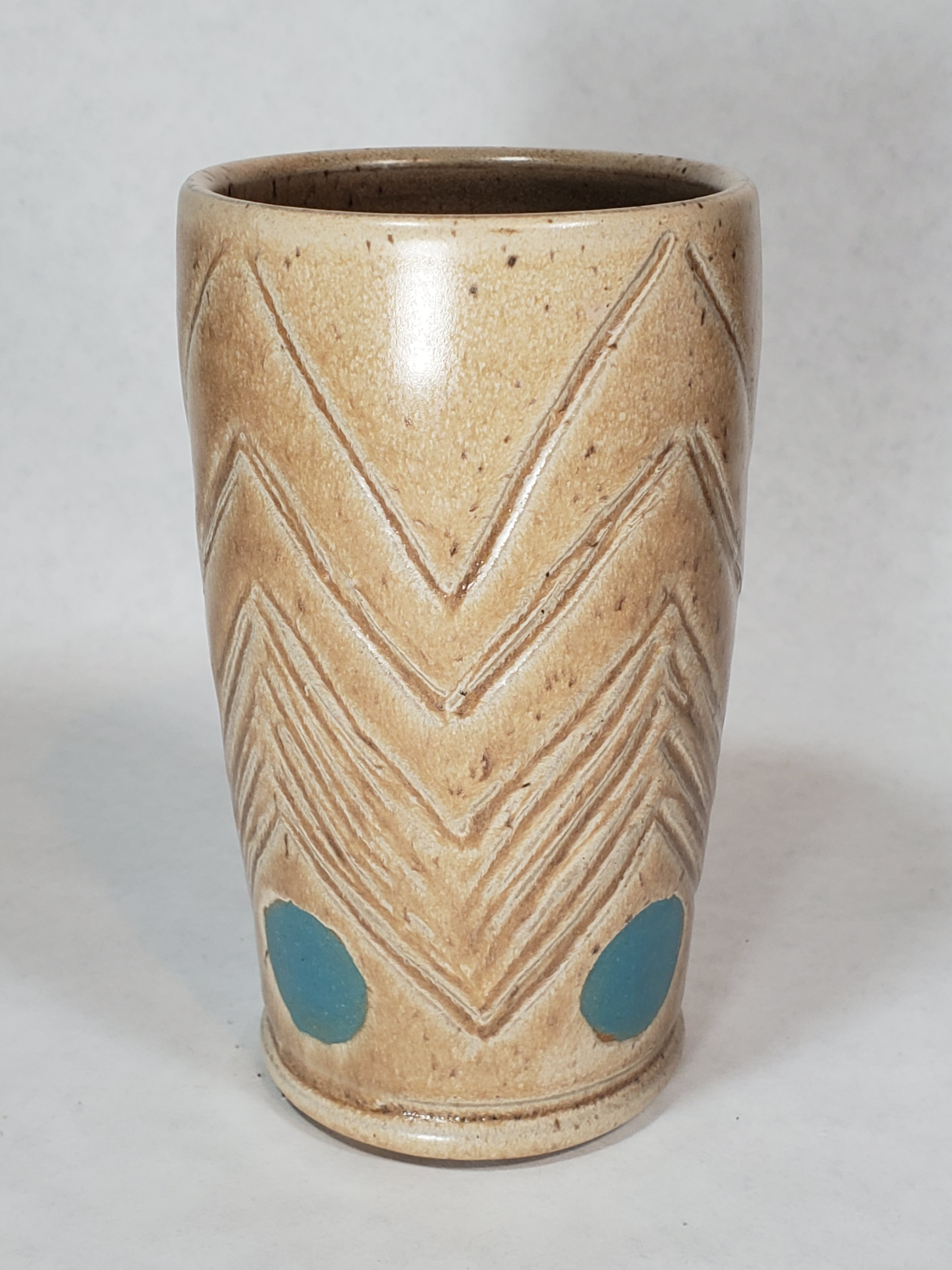 Tall drinking cup