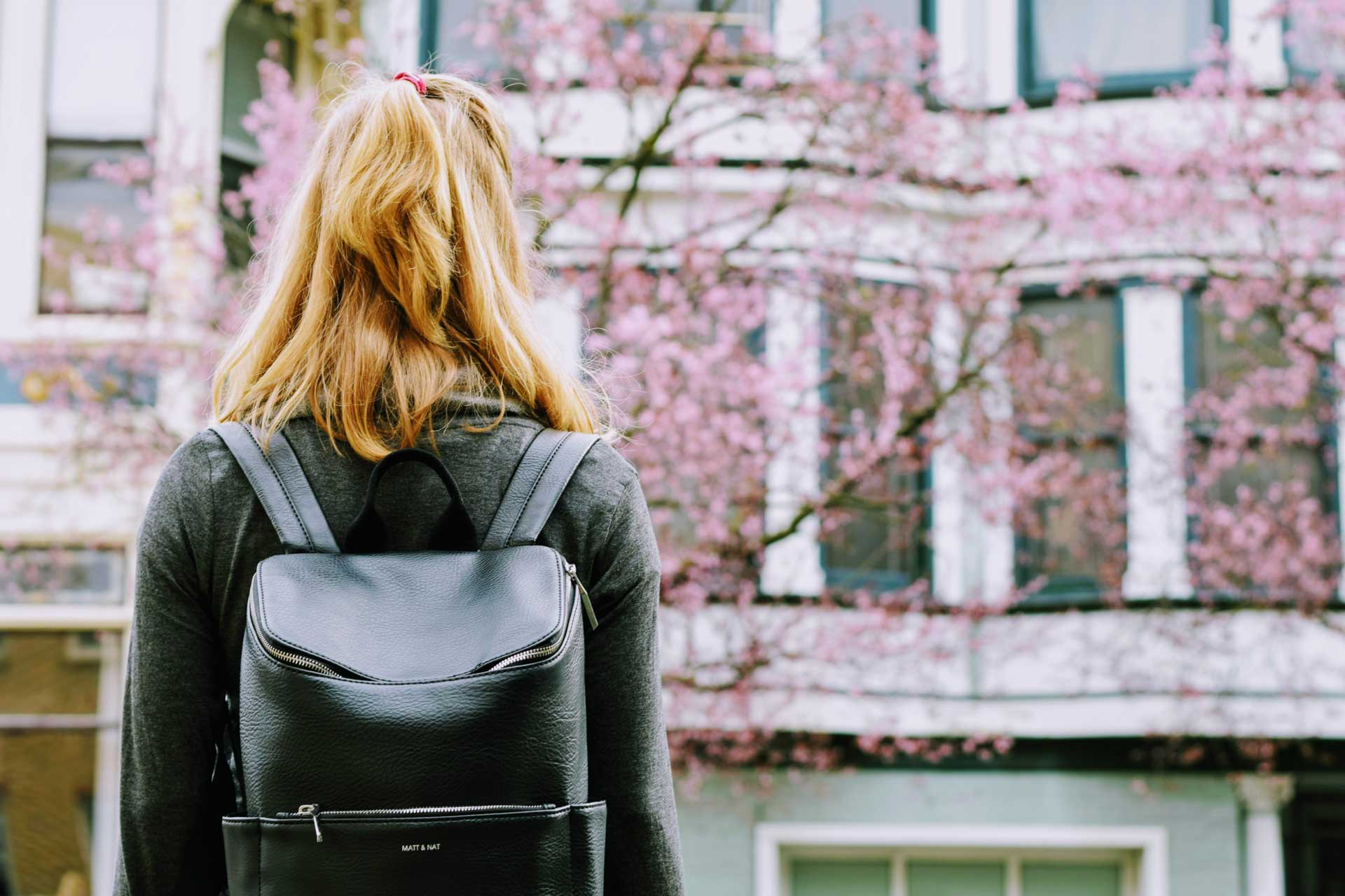 Back view of a girl with backpack