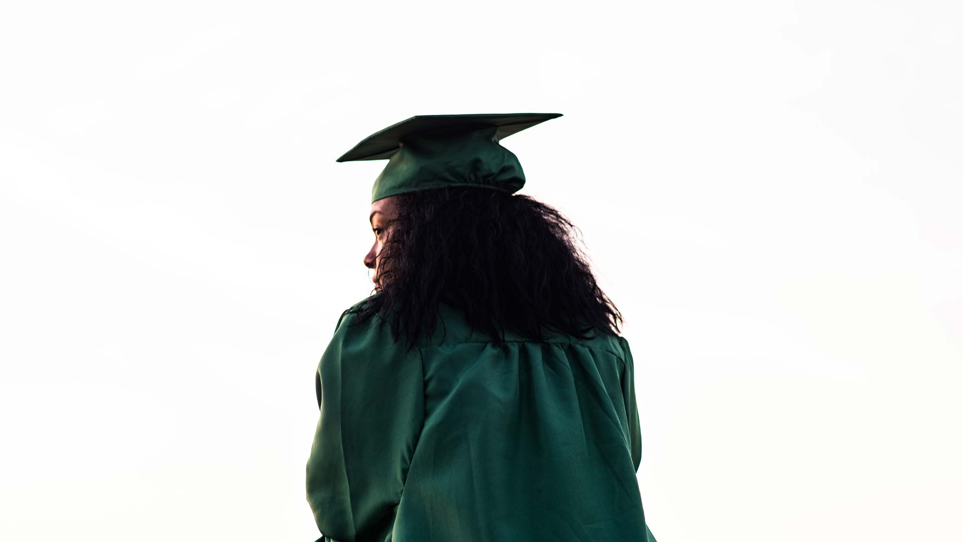 Pensive student in graduation robe
