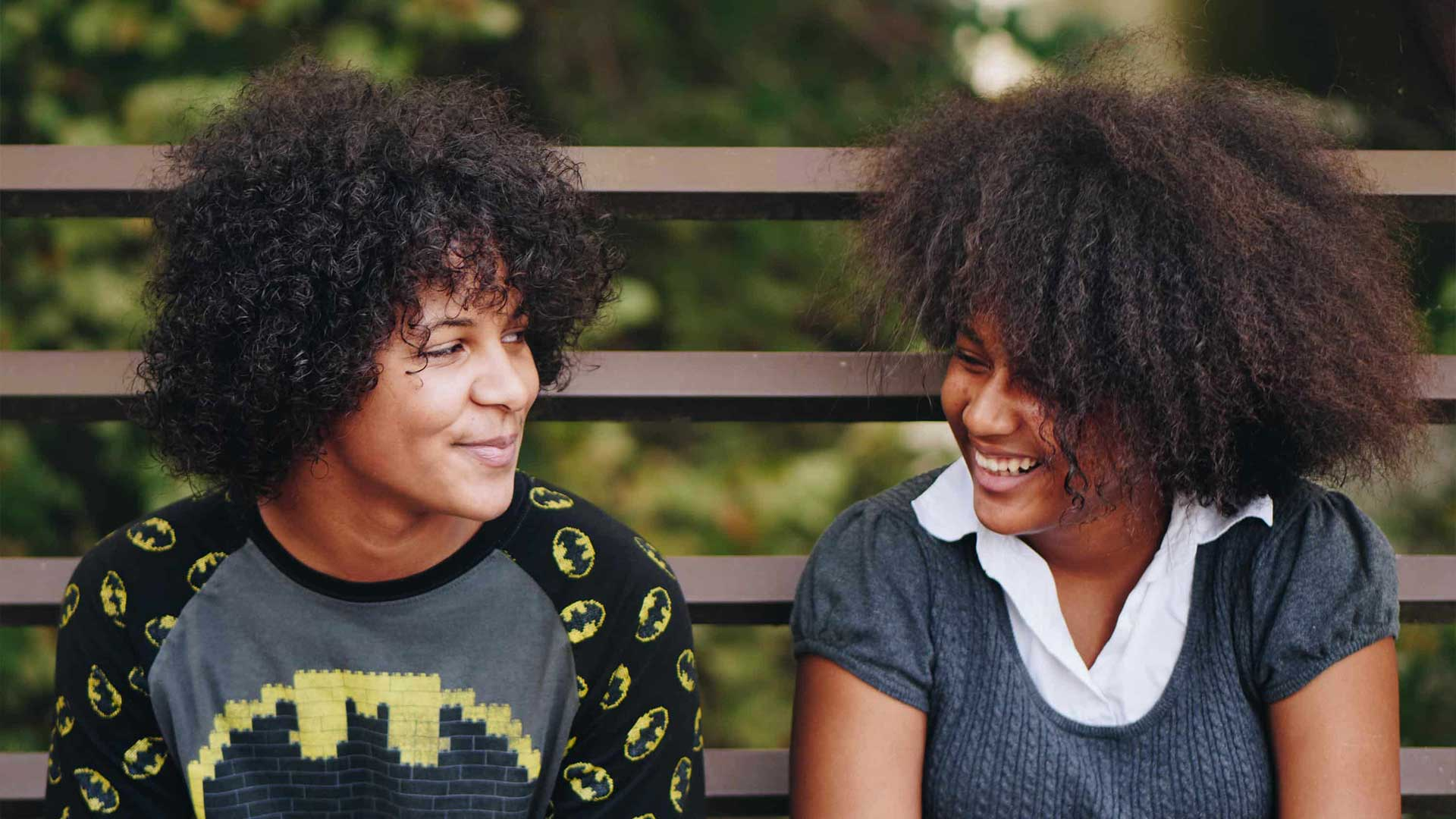 two teenage girls on a bench