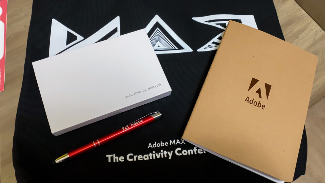 Adobe swag: Notebook, pen, bag