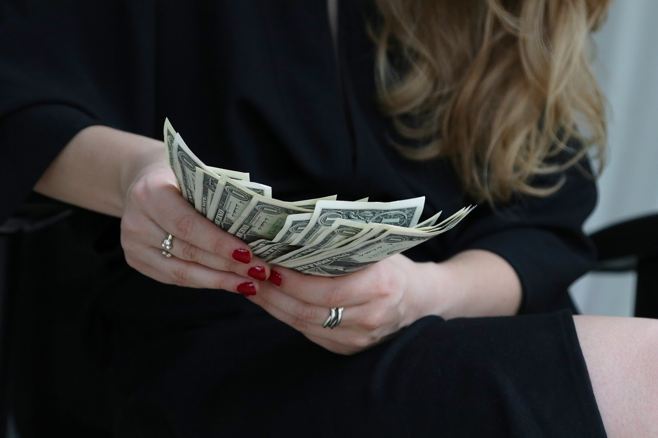 a woman holding cash