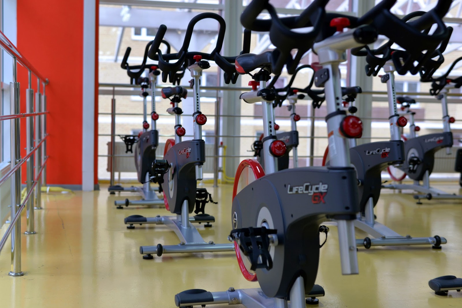 a room full of spin bikes ready for an adult cycling class