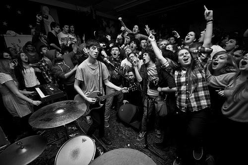 Tiger's Jaw plays a basement show for an enthusiastic crowd of young adults