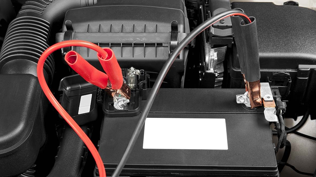 Red and Black jumper cables attached to a dead battery.