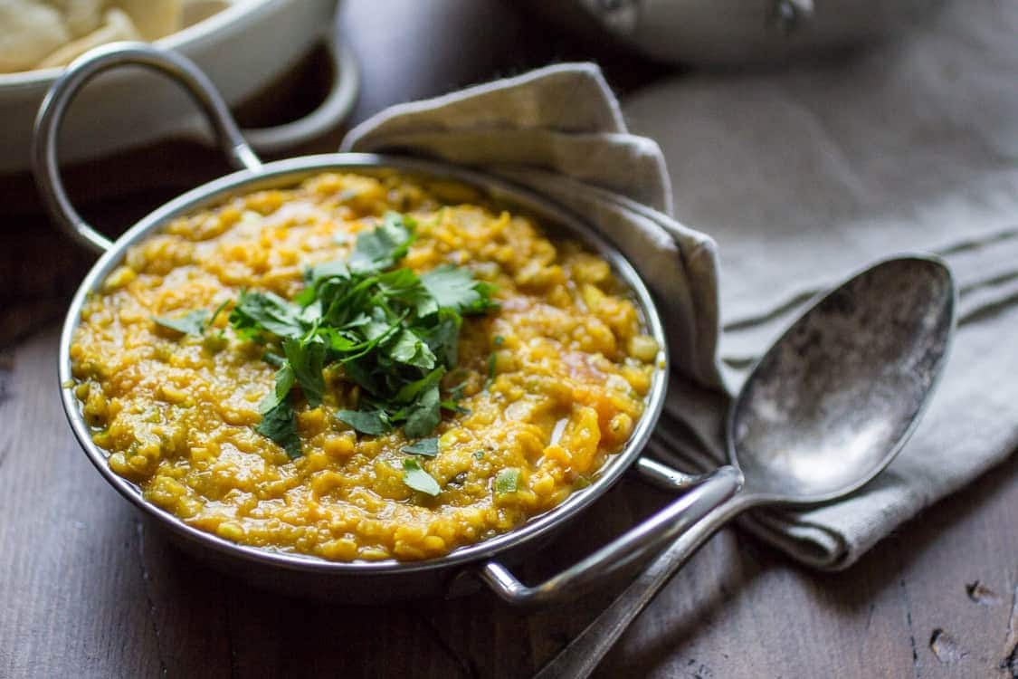 A bowl of Indian red lentil dal with plenty of protein from lentils.