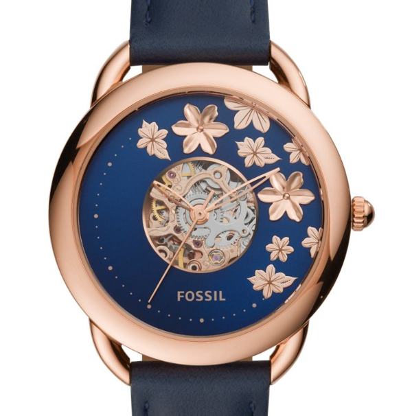 A gold watch with blue face with flowers