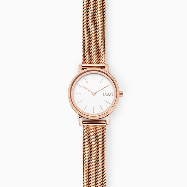 A gold watch with mesh band