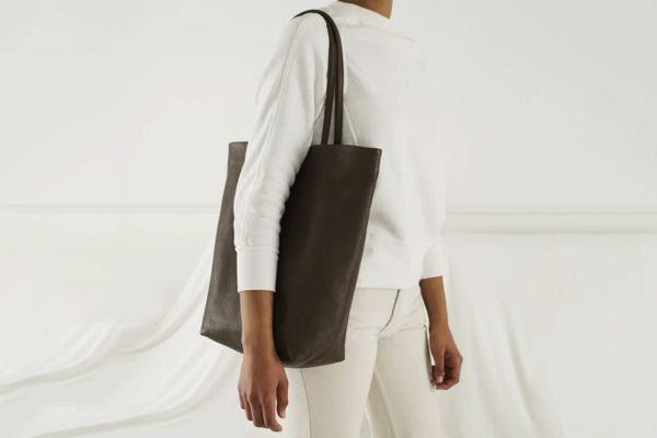 Lady carrying a brown tote bag