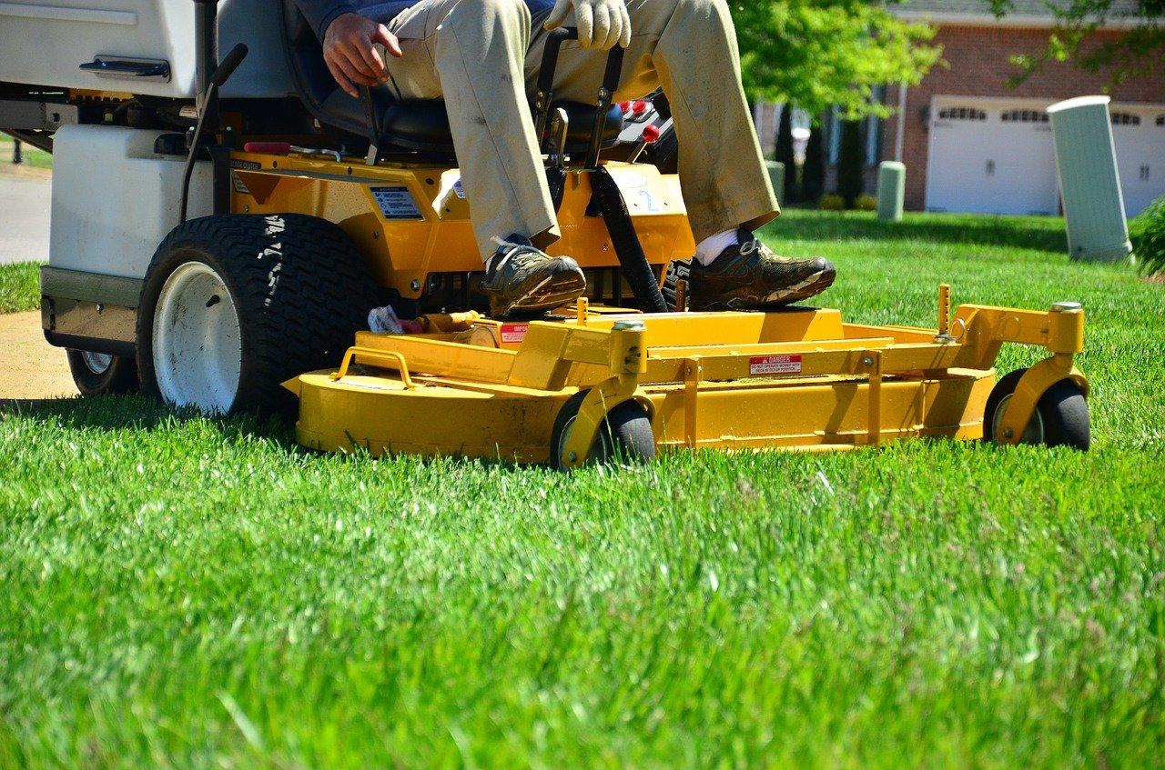 A riding mower cutting grass