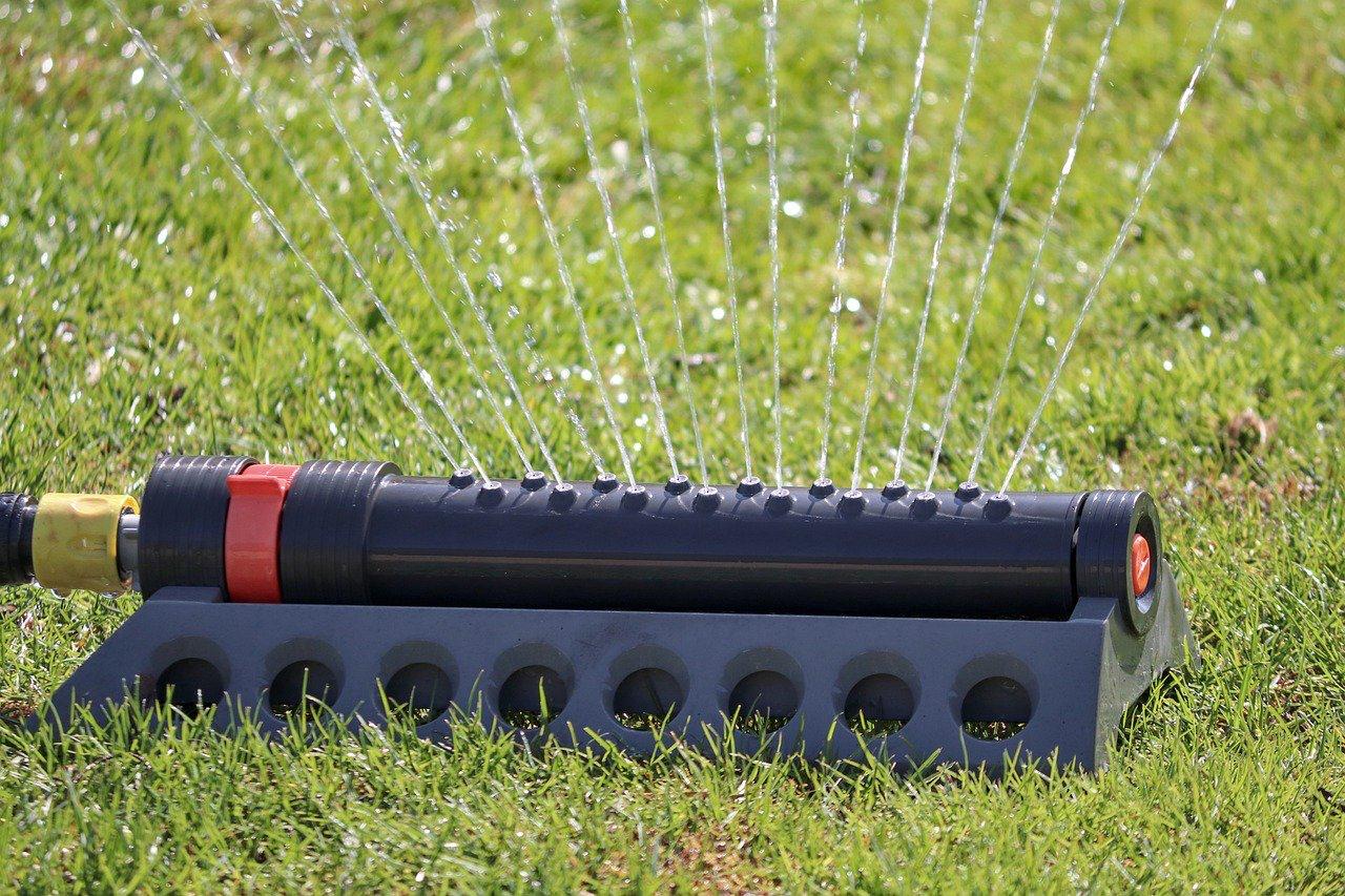 Sprinkler waters a lawn