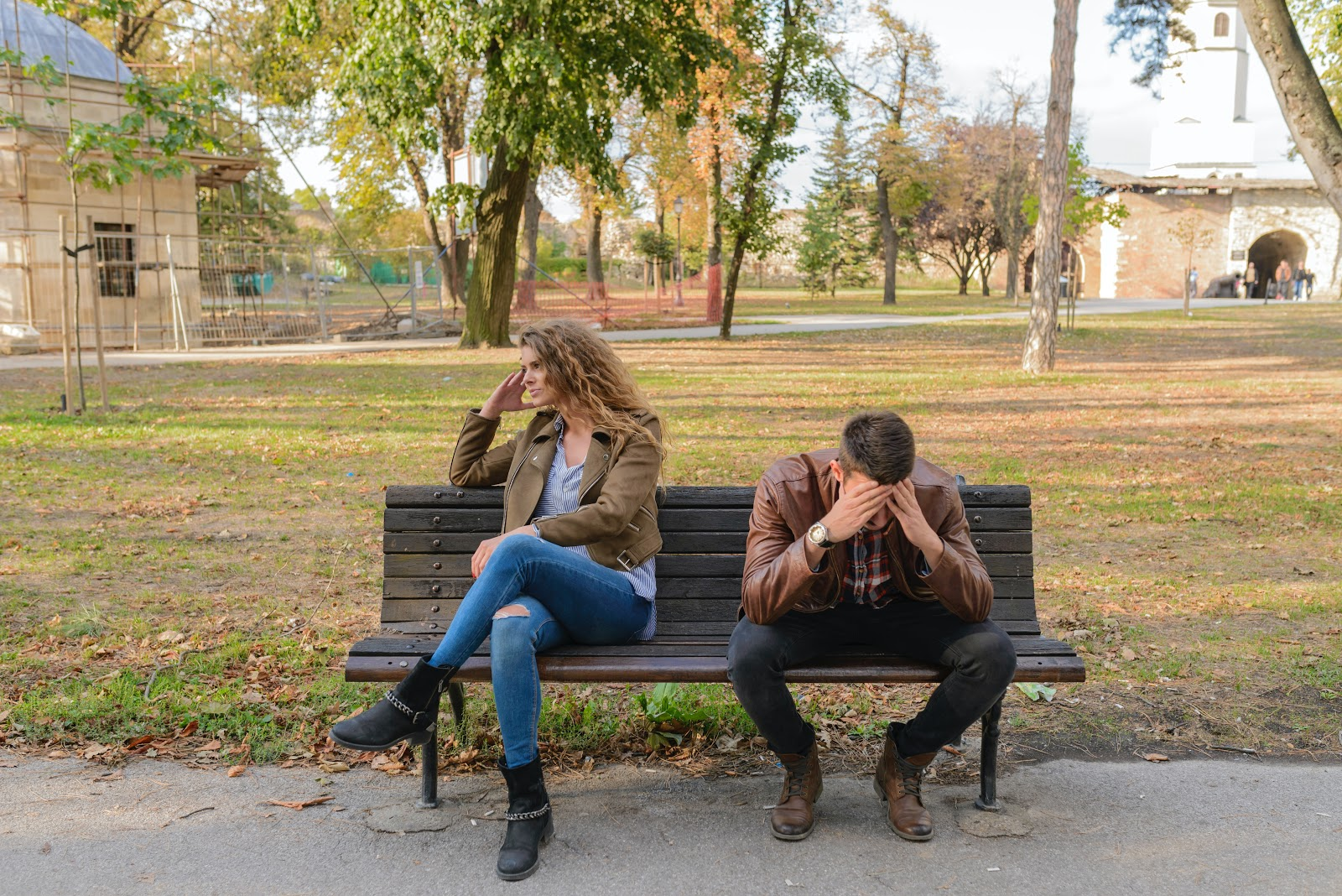 A couple on a bench struggles with communication.