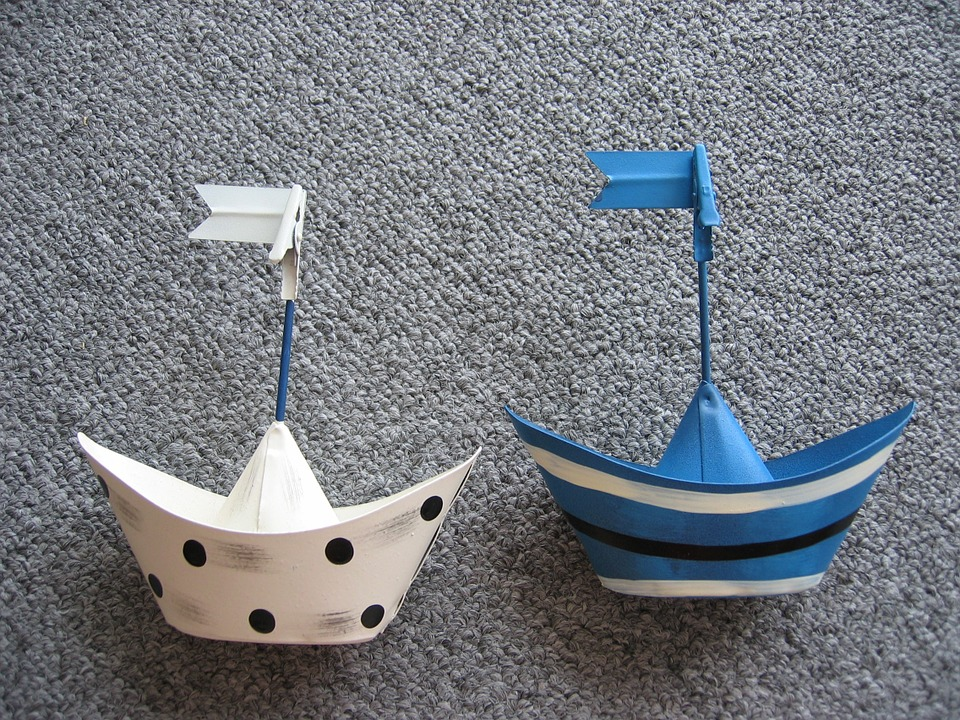 Two toy boats on a carpet