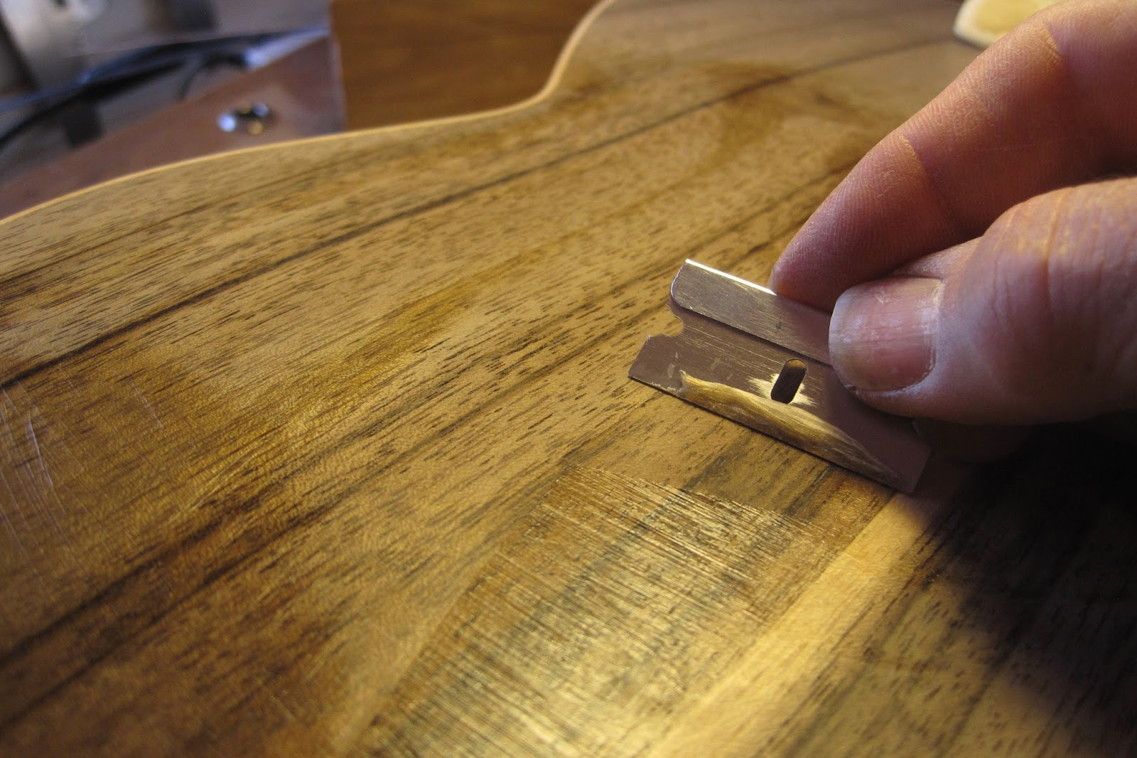 A razor is used to scrape off excess grain filler