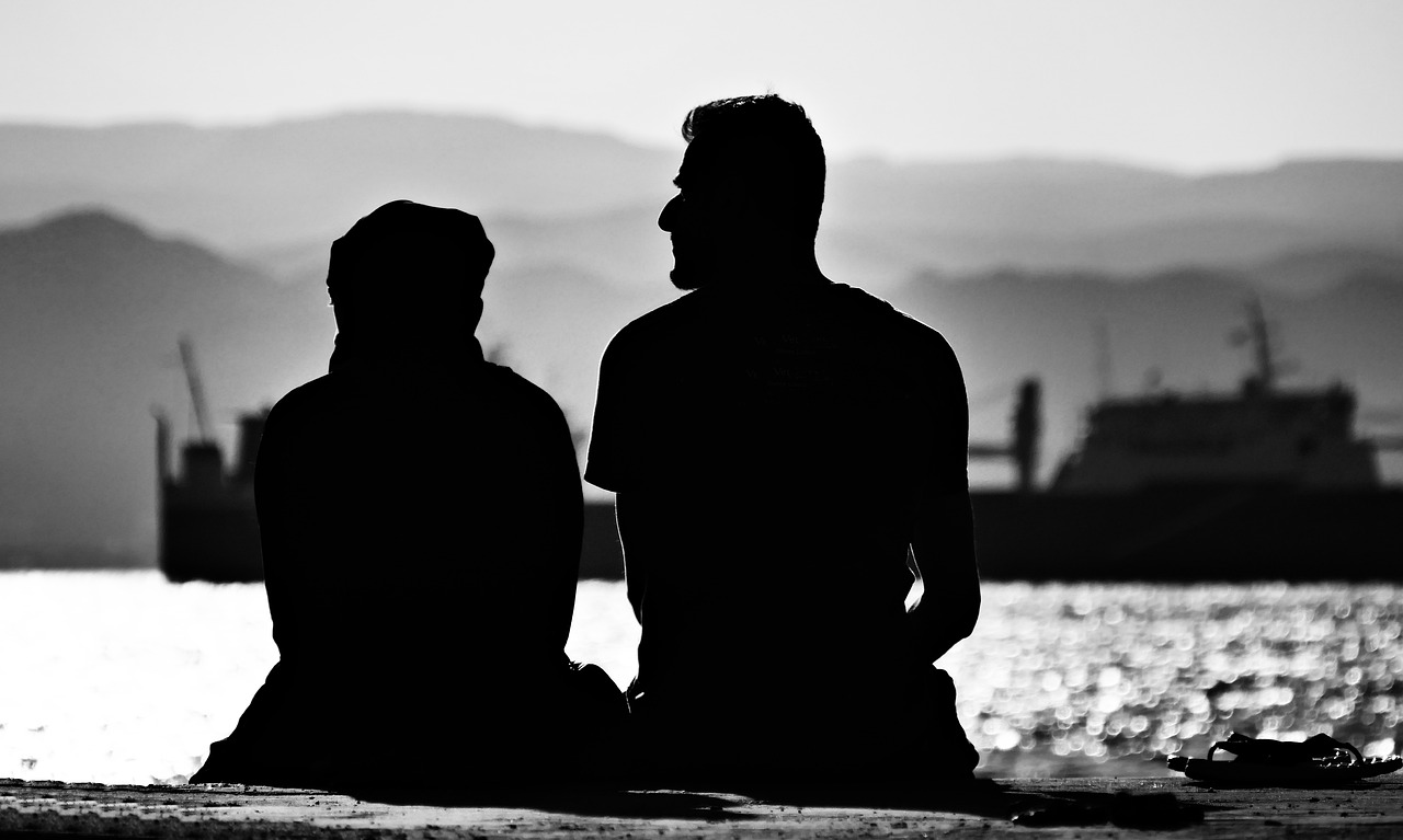 Photo of couple talking in shadow