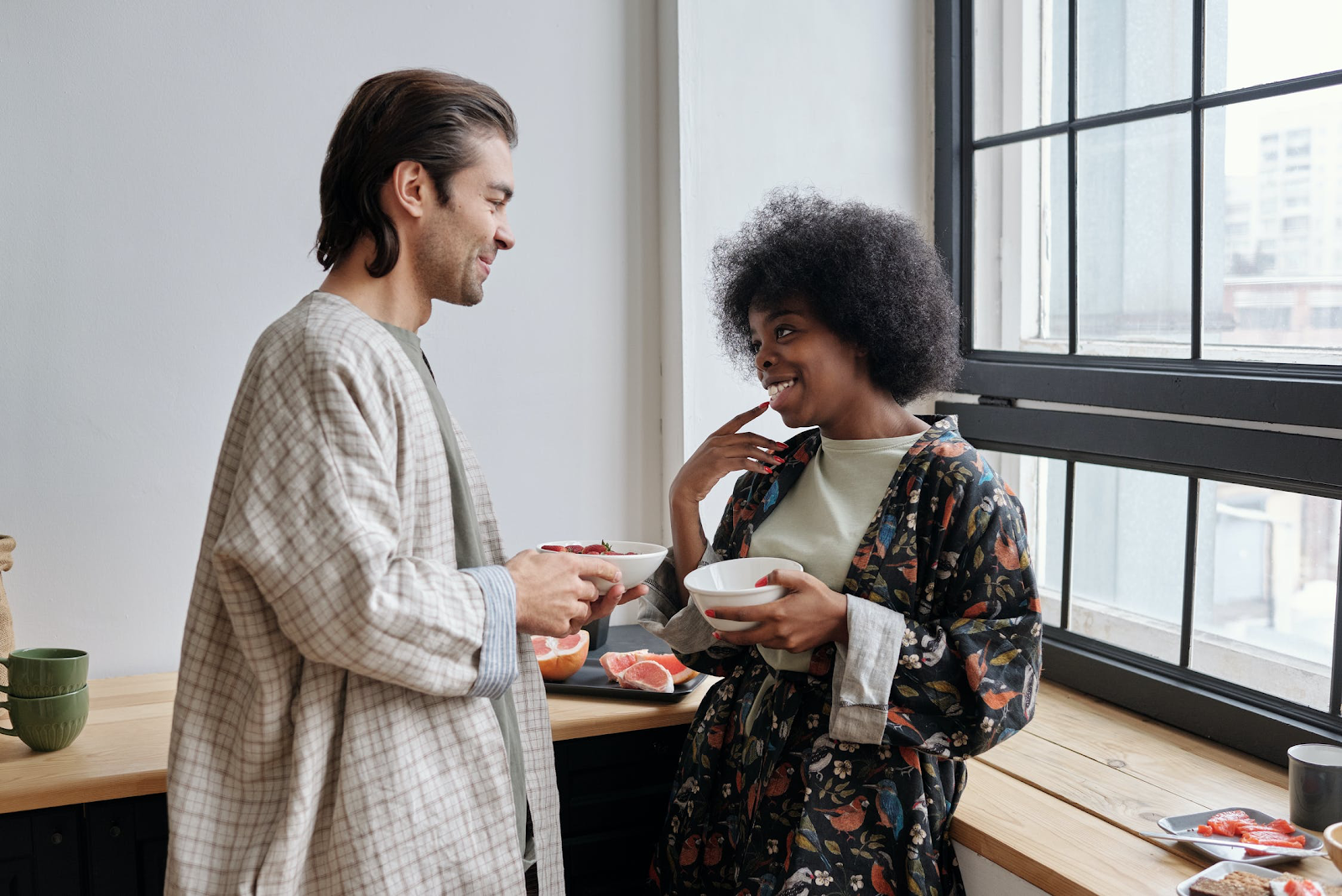 Photo of man and woman talking over breakfast