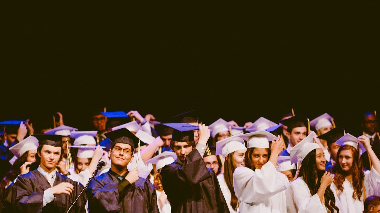 A graduating class moves their tassels during the graduation ceremony.