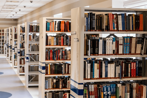 White bookshelves in a library