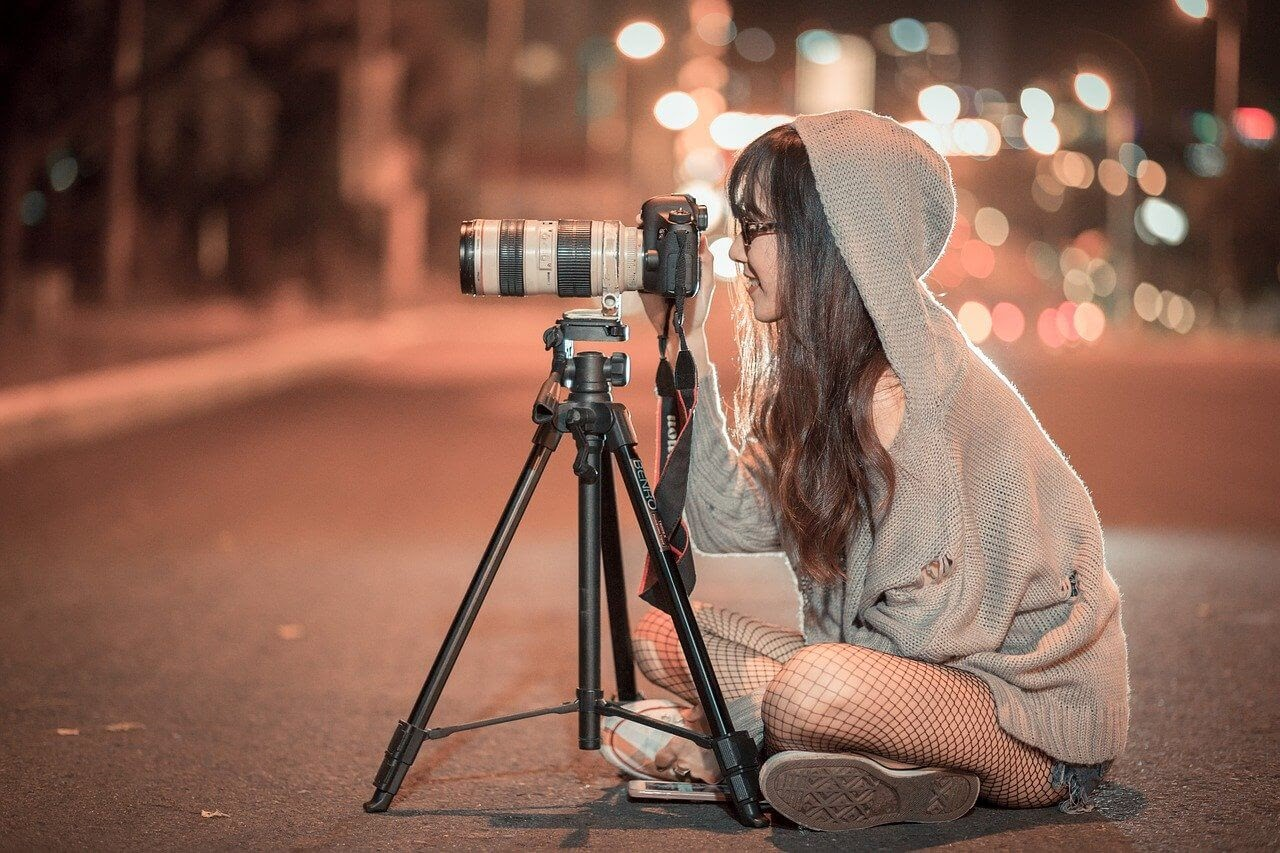 A photographer takes pictures at night in order to overcome creative burnout.