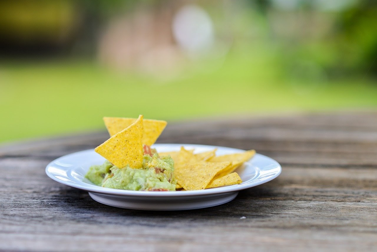 Chips on a plate of guac