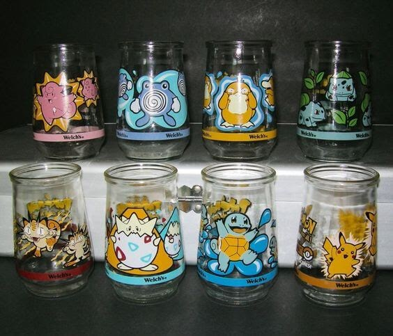 Photo of eight Welch's jelly jars with Pokemon designs