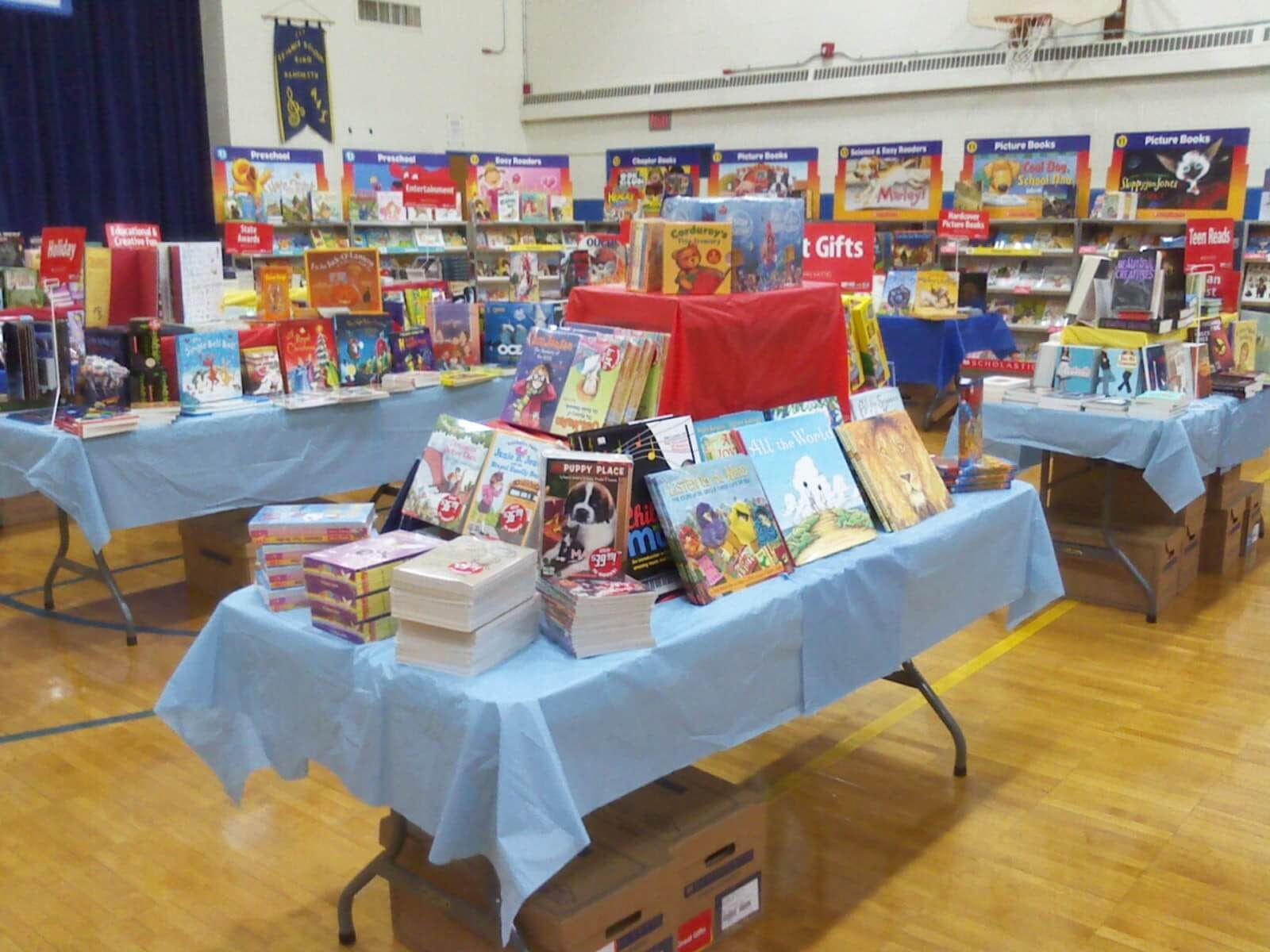 Photo of table with books displayed at a Scholastic Book Fair