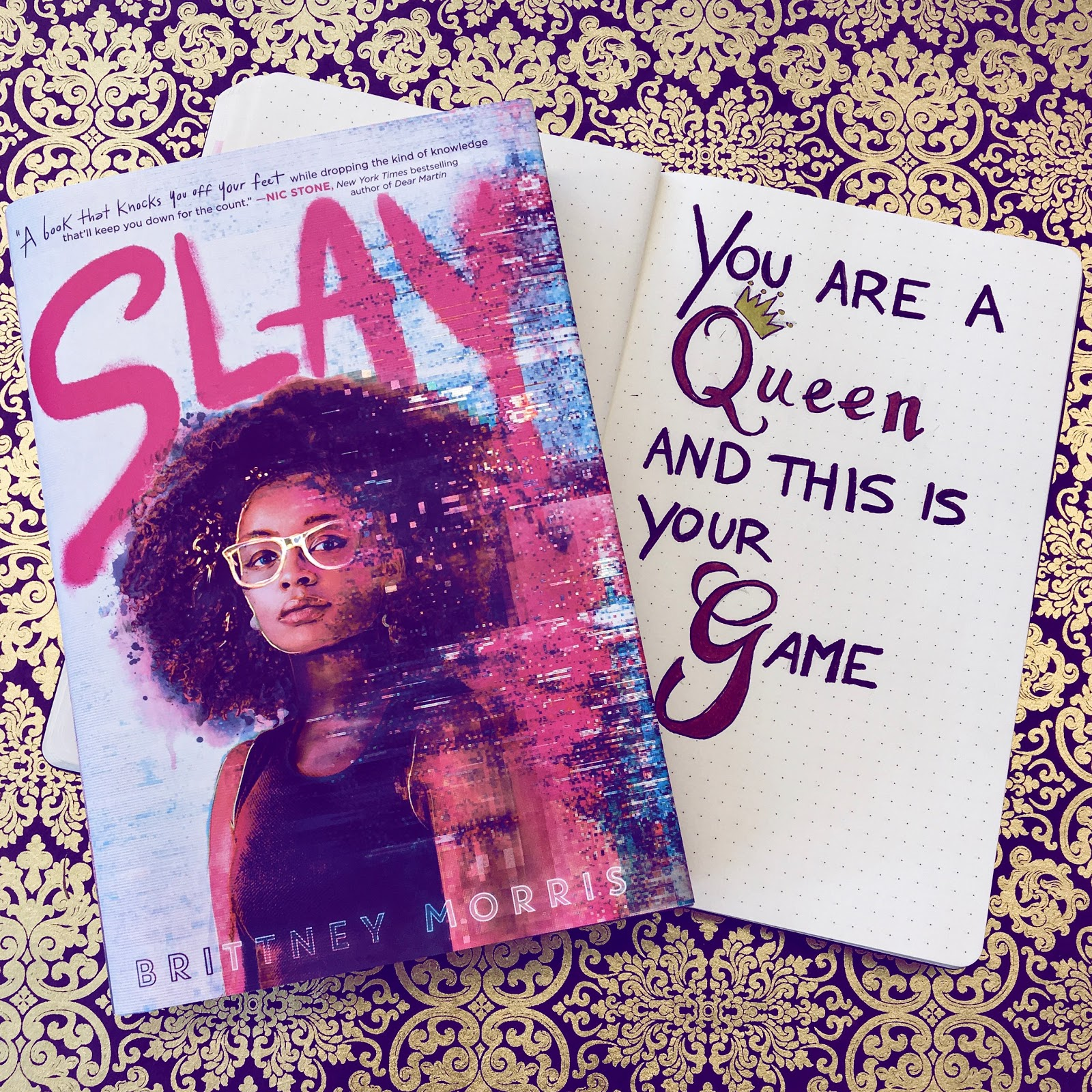 The cover of Slay by Brittney Morris is accompanied by the slogan: You are a Queen and this is your game.