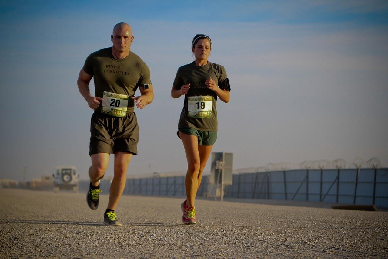 A man and woman run a race.