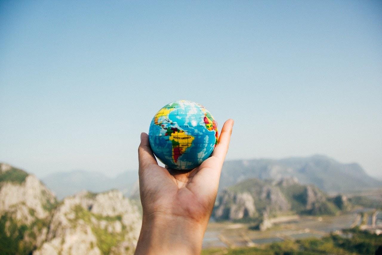 hand holding a tiny globe