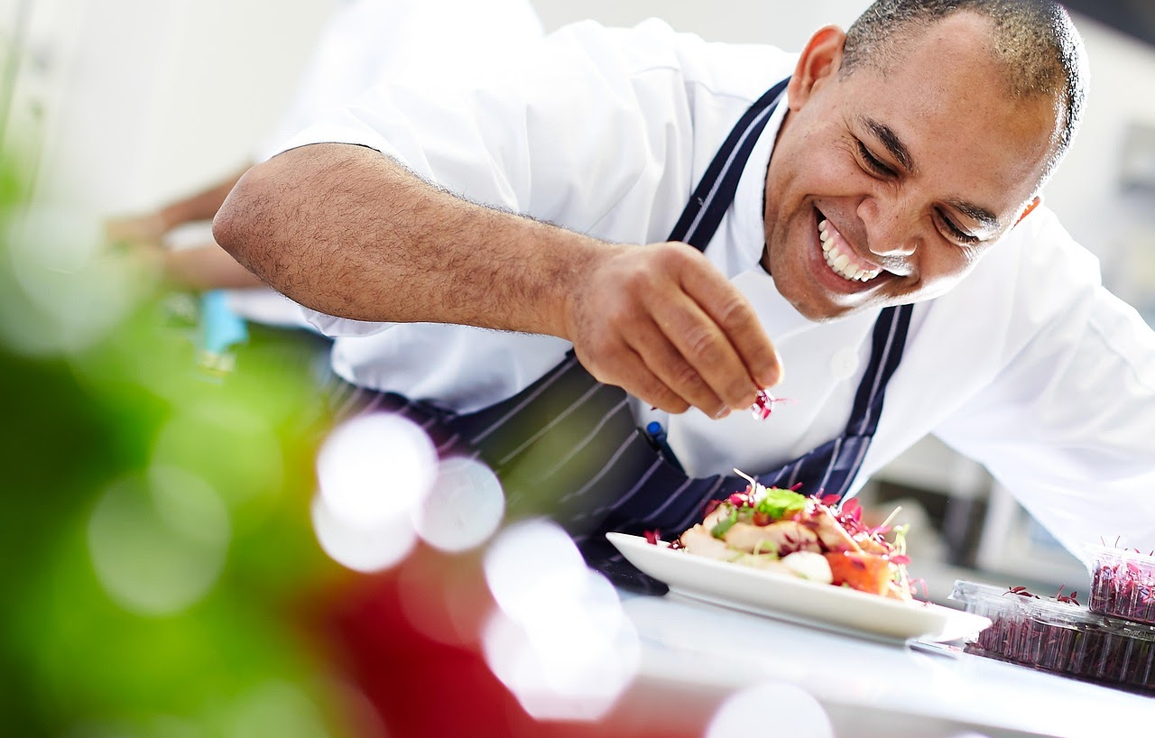 A chef plates a dinner for a wedding reception.