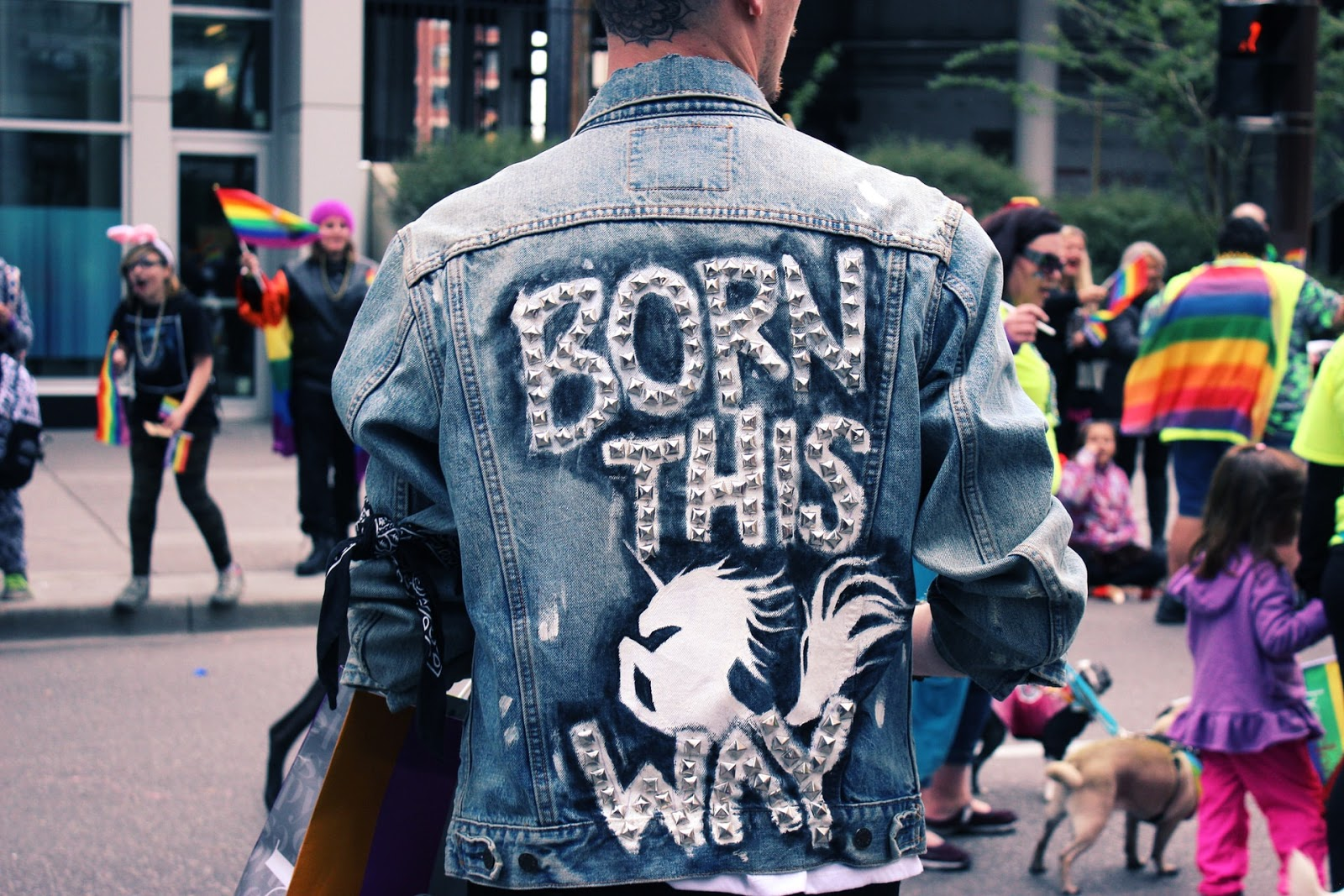 a man wearing a born this way denim jacket
