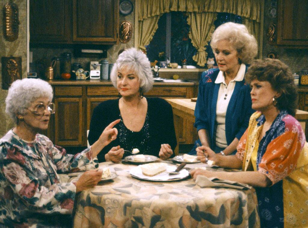 Four women sitting at a table in a kitchen. The four ladies from the television show the Golden Girls.