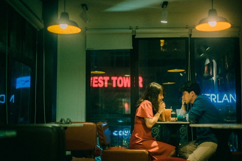 Couple in a diner drinking milkshake