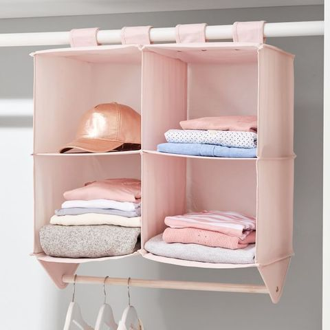 Image of a pink closet organizer hanging on a white rod