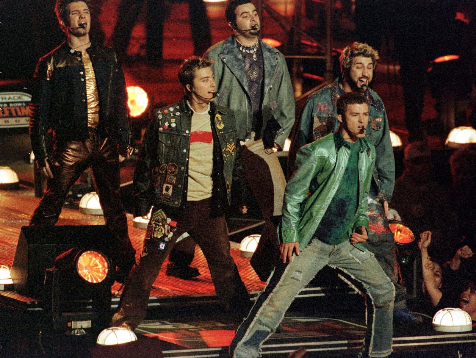 An image of NSYNC performing on stage