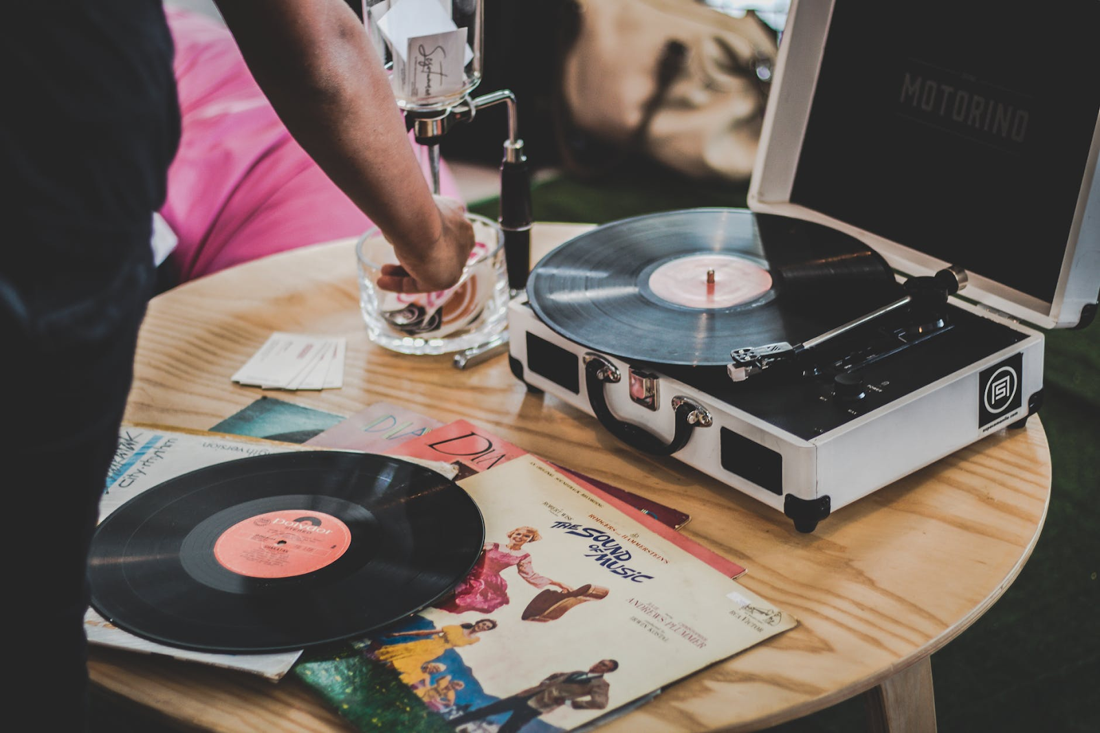 A vintage turntable playing a record in a millennial's house