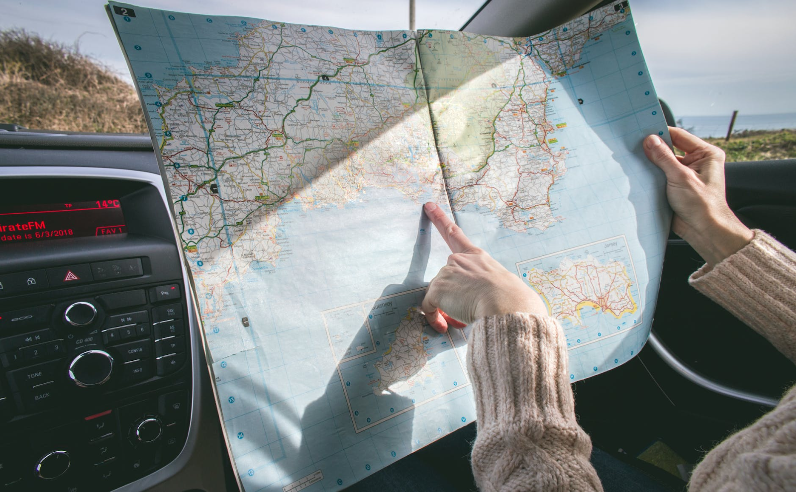 Using the old fashioned technique of finding where you need to go--a paper map.e