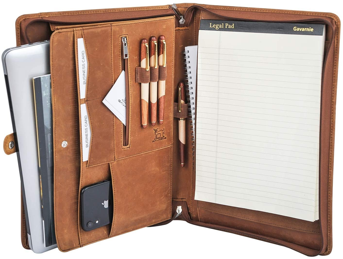 The inside of a brown padfolio filled with paper, pens and technology devices.