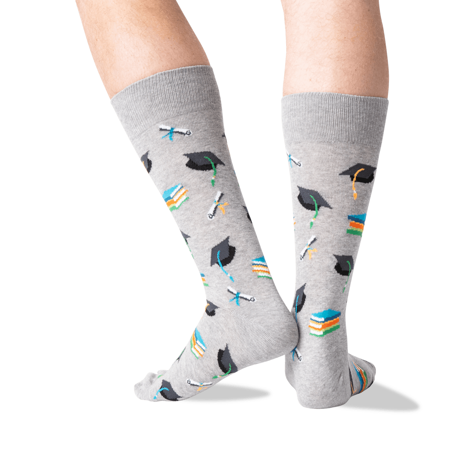 A gray pair of socks with graduation hats and diplomas on them.