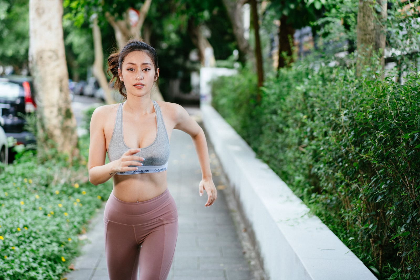 Young adult woman jogging.