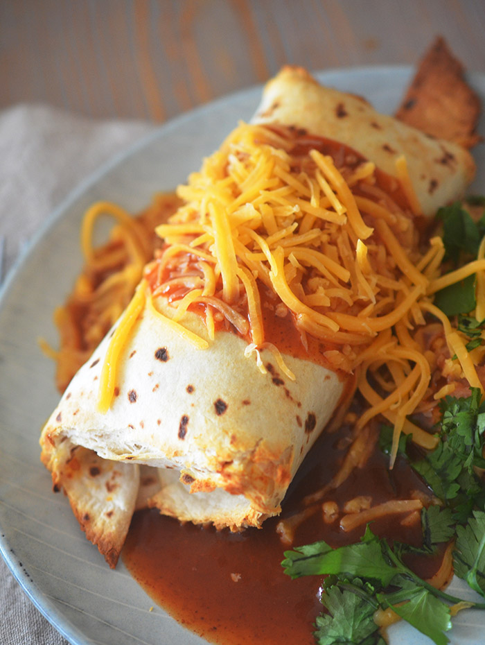 Chimichangas made in the air fryer with cheese on top