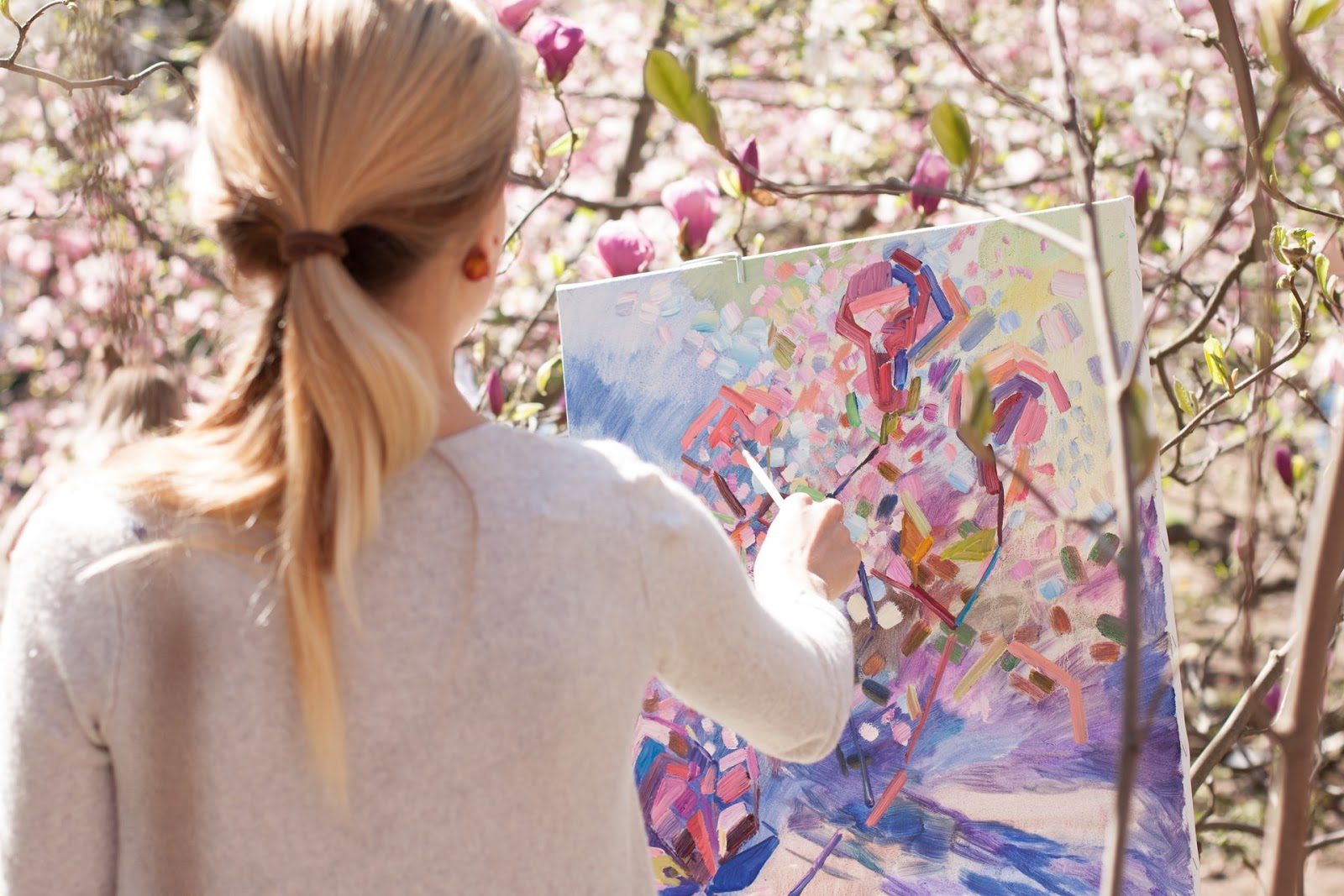 woman painting abstract flowers