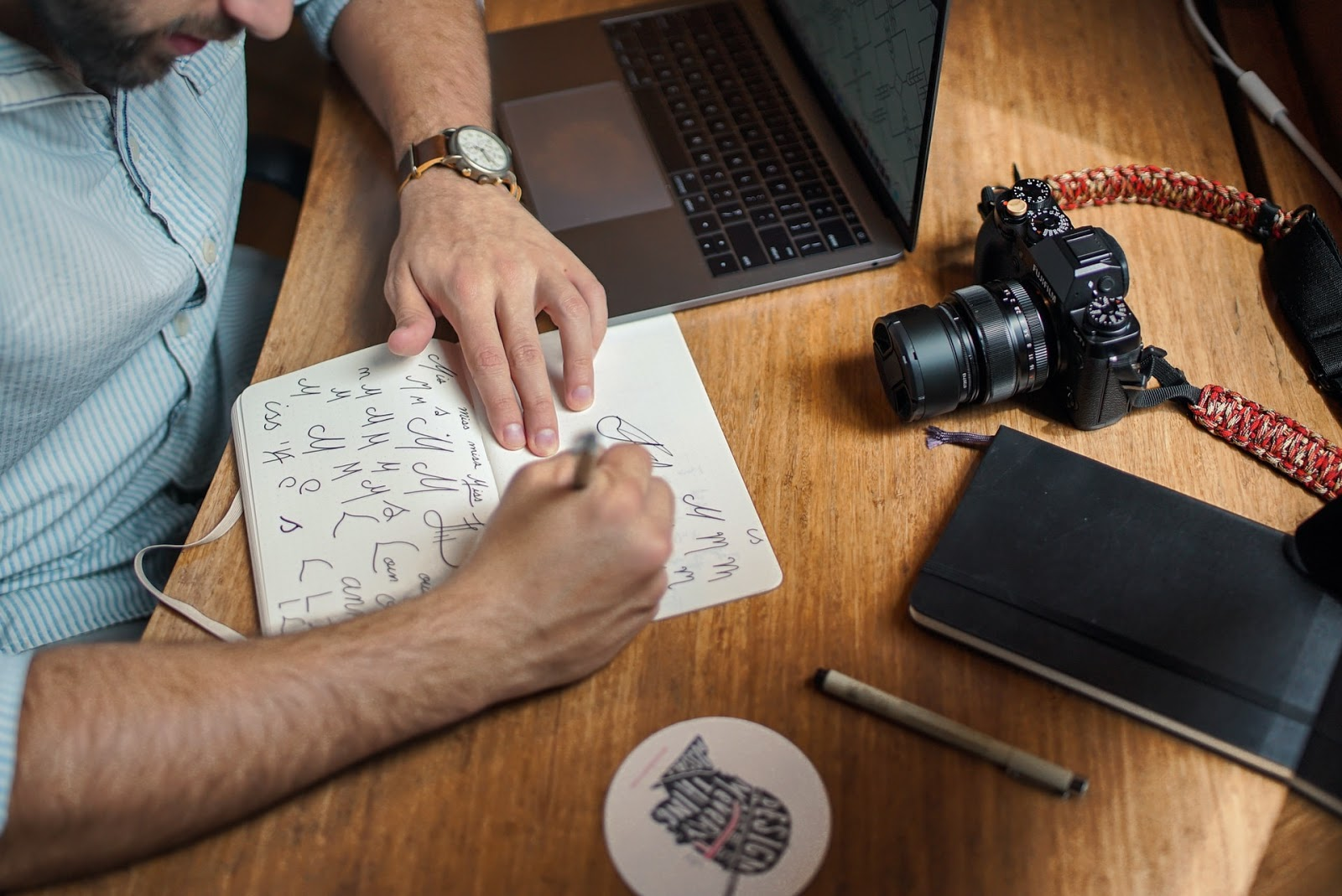 a designer working out a design in his notebook