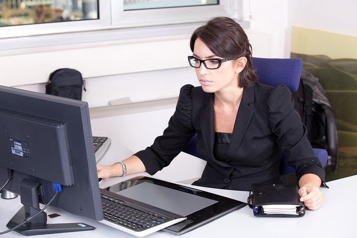 an accountant gets set up at her desk