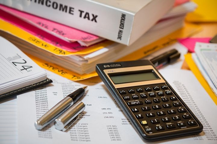 a calculator, documents, and tax related books