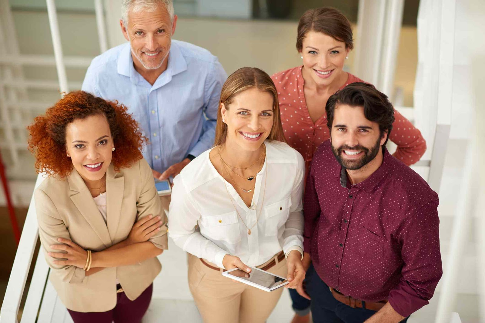 a group of employees dressed in colorful, smart casual attire