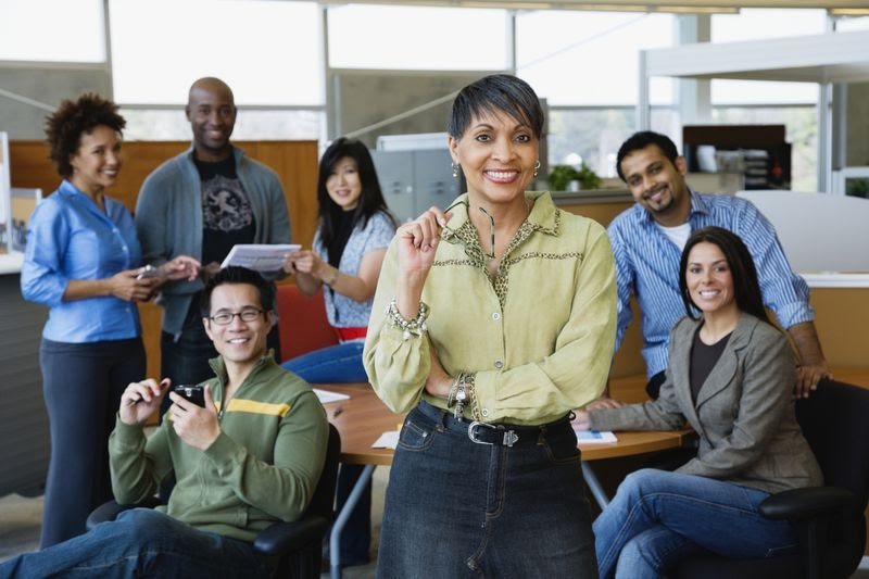 a business casual group of employees dressed in jeans and casual tops