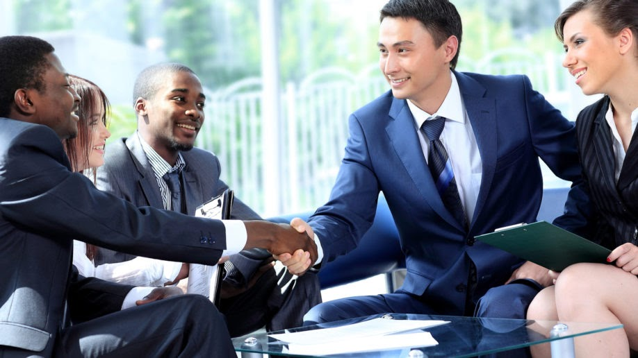 business men and women in business formal attire have a meeting