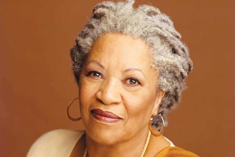 Toni Morrison poses with a soft smile in a headshot.