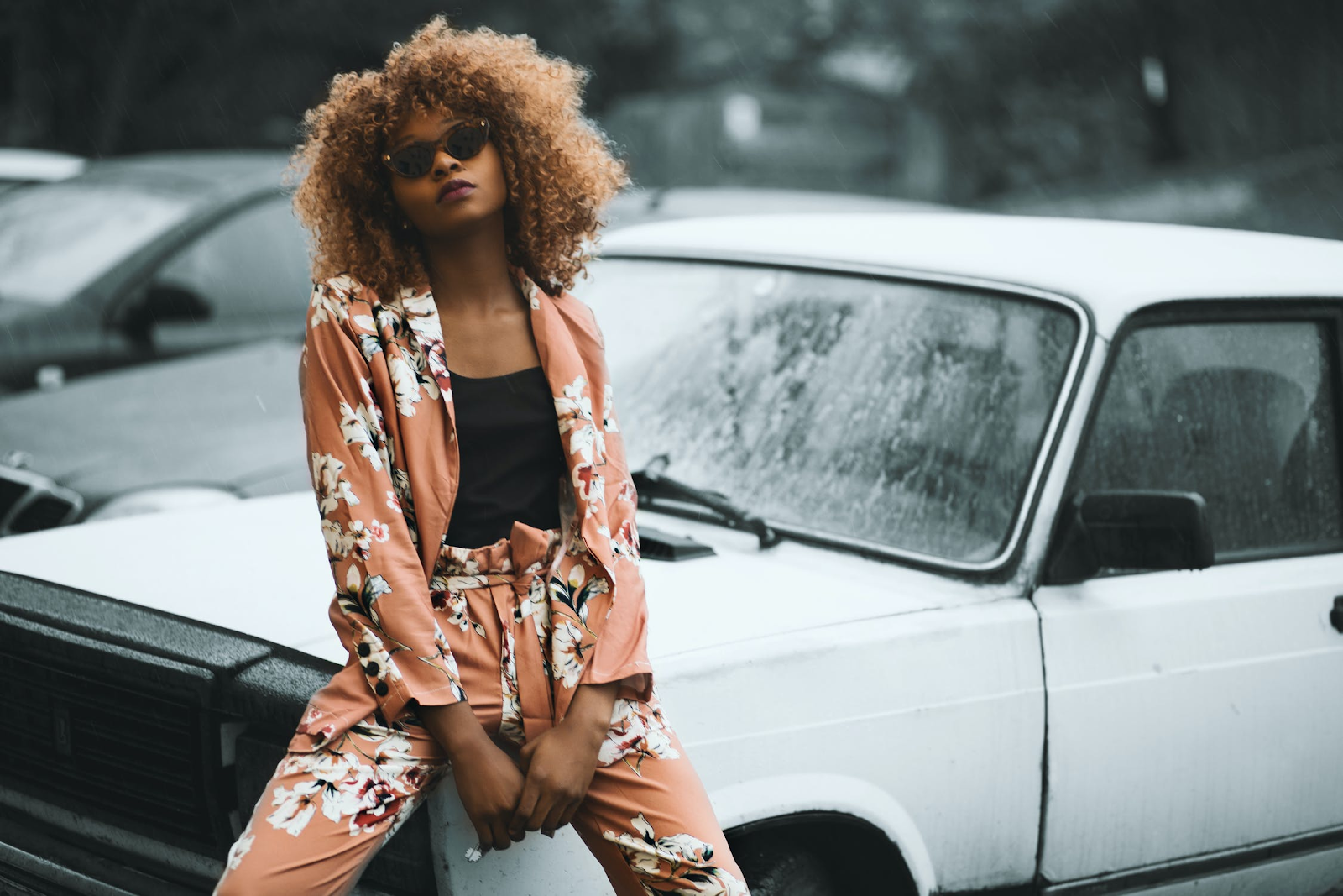 Young adult woman establishes her unique fashion sense with a fun patterned suit.
